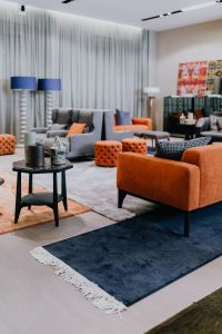 Kaboompics - Modern luxury furniture in showroom store, armchairs, sofa. table, laps, rugs