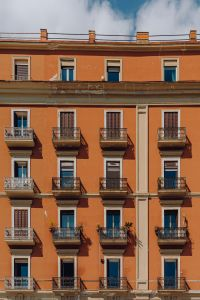 Kaboompics - The facade of an orange tenement house in Naples