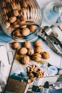 Kaboompics - Glass jar full of walnuts and a nutcracker