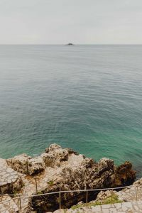Rocky coastline on the Adriatic Sea in the small town of Rovinj, Croatia