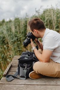 Kaboompics - Photographer holding a DSLR camera
