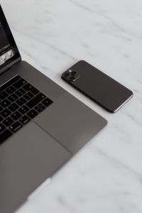 Kaboompics - MacBook Pro 15 laptop and iPhone 11 Pro on a marble table