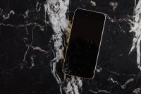 Broken Mobile on Marble Table