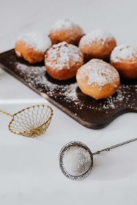 Homemade Polish doughnuts with cherry filling, covered with powdered sugar. Traditional speciality on Fat Thursday in Poland.