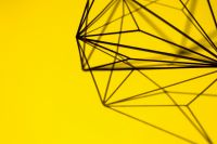 Kaboompics - Geometric decoration on yellow background