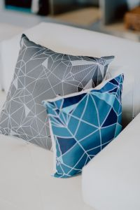 Kaboompics - Scandinavian decorative pillows on modern sofa