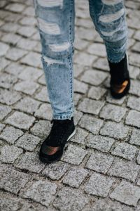 Kaboompics - Woman in black sneakers and blue jeans