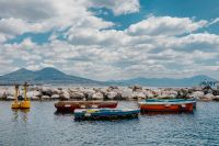 A small fishing boats & Volcano Mount Vesuvius (Vesuvio)