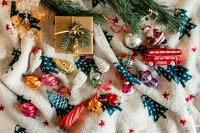 Kaboompics - Christmas gift and colourful tree decorations on a blanket