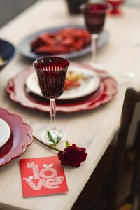 Kaboompics - Fancy dinner with seafood pasta, crayfish and red wine by the table decorated with roses