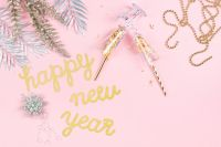 Kaboompics - New Years Eve party decorations on pink background