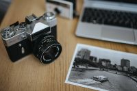 Kaboompics - Old Zenit camera with a laptop and a black-and-white photo