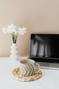 Kaboompics - Laptop - white flowers & cup of coffee on marble table