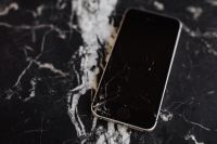 Kaboompics - Broken Mobile on Marble Table