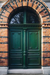Kaboompics - GReen Front Door on a Brick Building