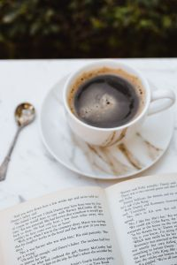 Kaboompics - Cup of Coffee and an Open Book