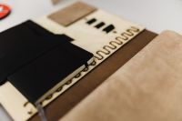 Kaboompics - Architecture plans in an elegant leather bag