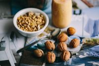 Kaboompics - Walnuts with a fresh healthy shake and musli in a bowl