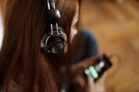 Kaboompics - Beautiful young woman in headphones listening to music