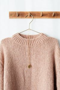 Kaboompics - Sweater on hanger