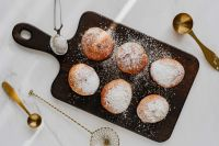 Kaboompics - Homemade doughnuts covered with powdered sugar. Traditional speciality on Fat Thursday in Poland.
