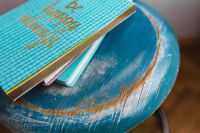 Kaboompics - Blue notebooks on a blue wooden stool
