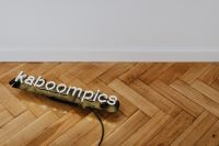 Neon Kaboompics on wooden parquet flooring