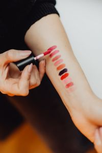 Lipstick swatches on woman hand