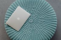 Kaboompics - MacBook Laptop on a blue pouf