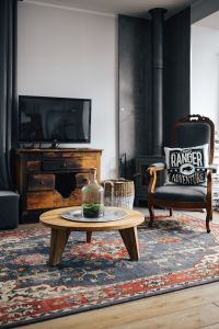 Kaboompics - Living room, wooden furniture, table, armchair, tv, carpet