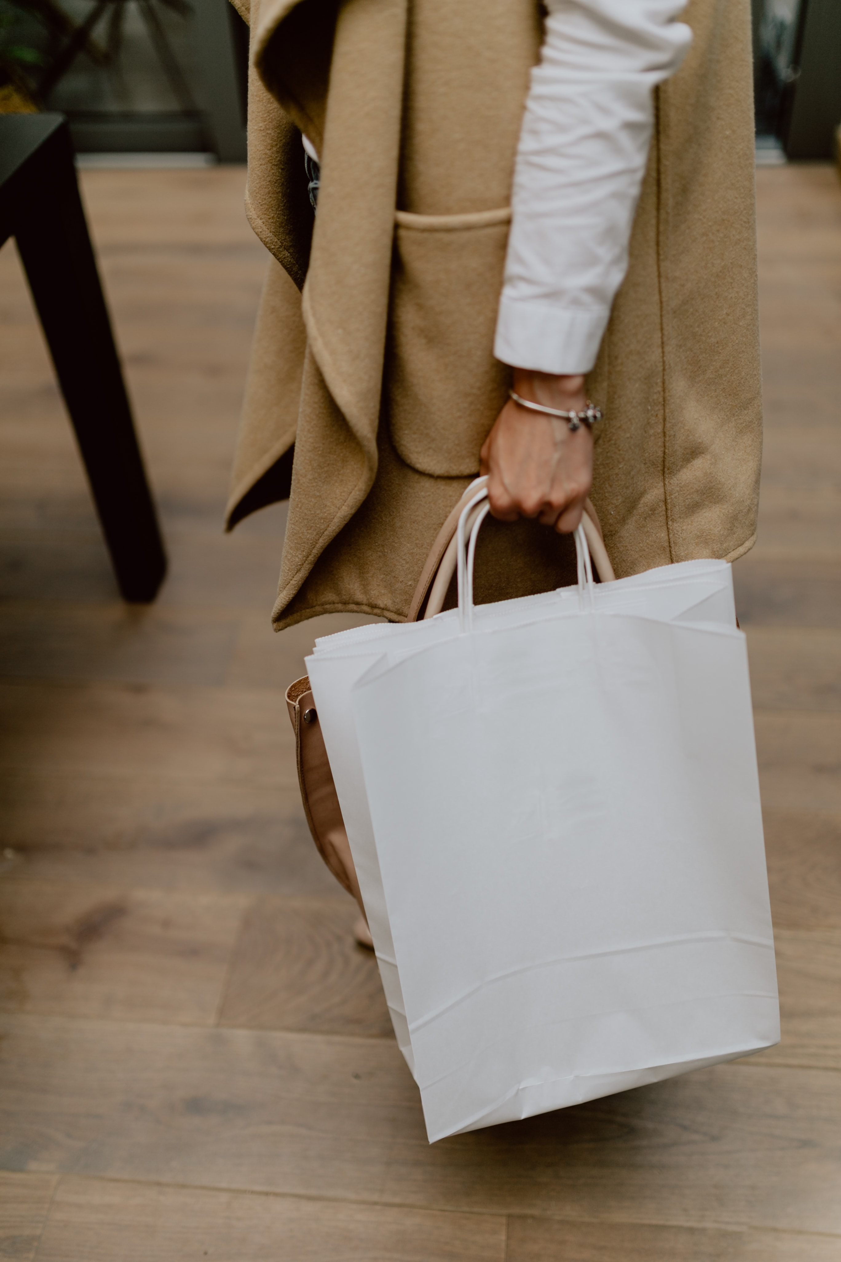 Woman with blank paper bag
