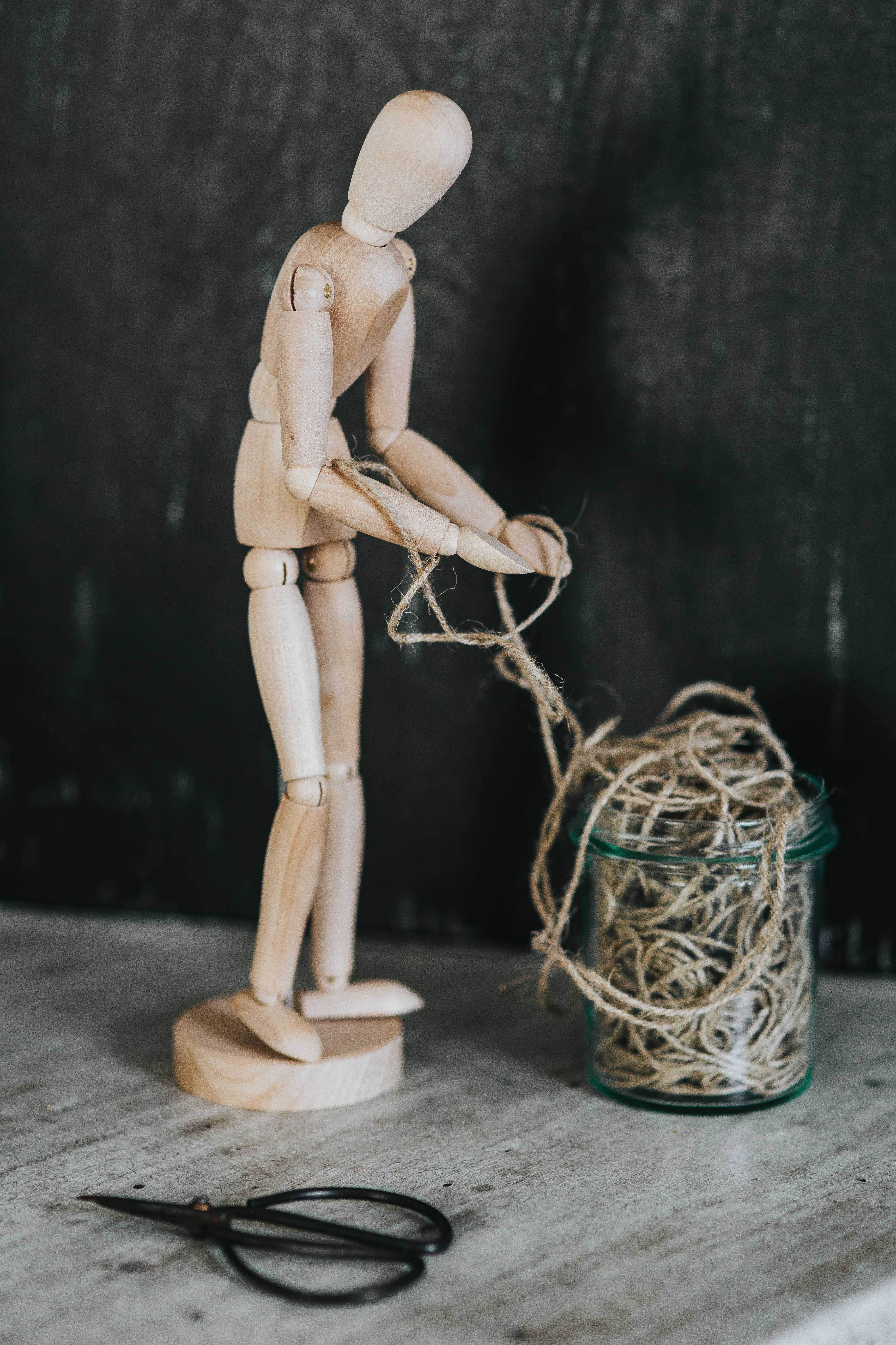 Wooden mannequin in various poses